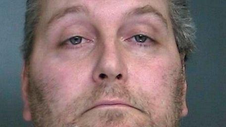 Alan Bauser, 42, of Medford, was arrested Saturday,