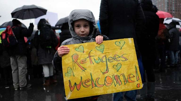 A boy holds a placard at the Rally