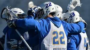 Josh Byrne (22) and Hofstra teammates celebrate after