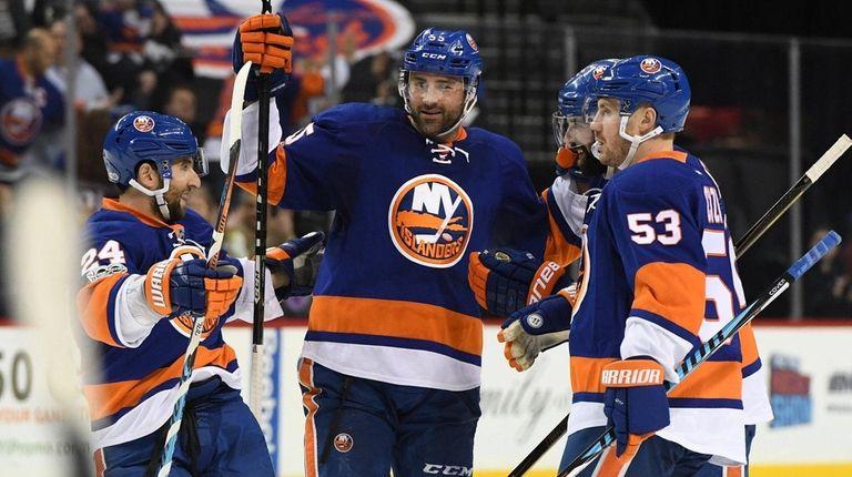 New York Islanders players celebrate a goal by