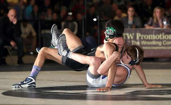 Eastport-South Manor's Adam Busiello, bottom,controls Rocky Point's Anthony