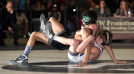 Eastport-South Manor's Adam Busiello, bottom, controls Rocky Point's Anthony