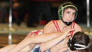 Half Hollow Hills West's Dylan Ryder, top, wrestles