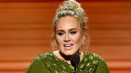 Songwriter and singer Adele accepts the song of