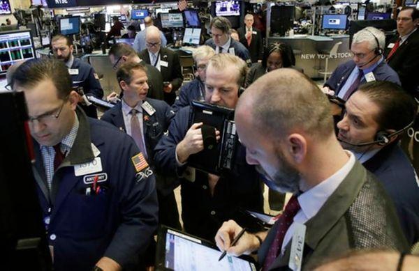 Stock traders follow market activity, Thursday, Feb. 9,