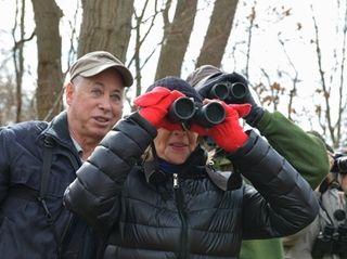 Bruce Brecher helps Lois Riss spot a Carolina