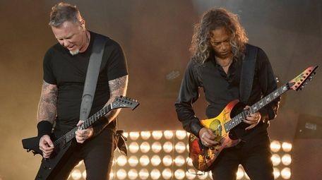 Metallica's James Hetfield, left, and Kirk Hammett perform