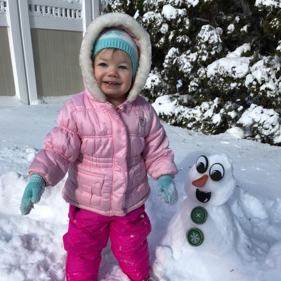 Brianna builds her first snowman in Centereach