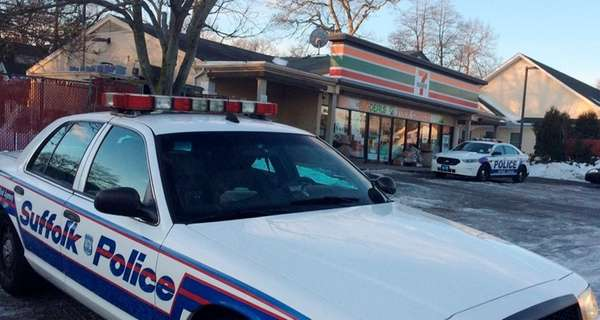 Suffolk County police investigate a robbery at a 7-Eleven