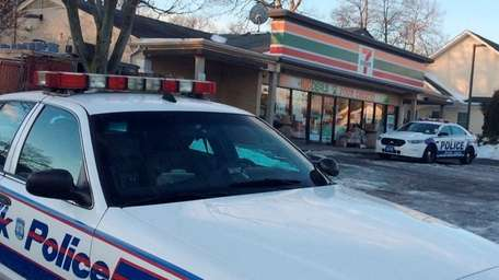 Suffolk County police investigate a robberyat a 7-Eleven