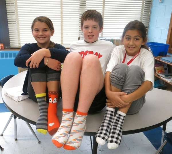 Kidsday reporters Isabella Basini, left, Seamus Smith and