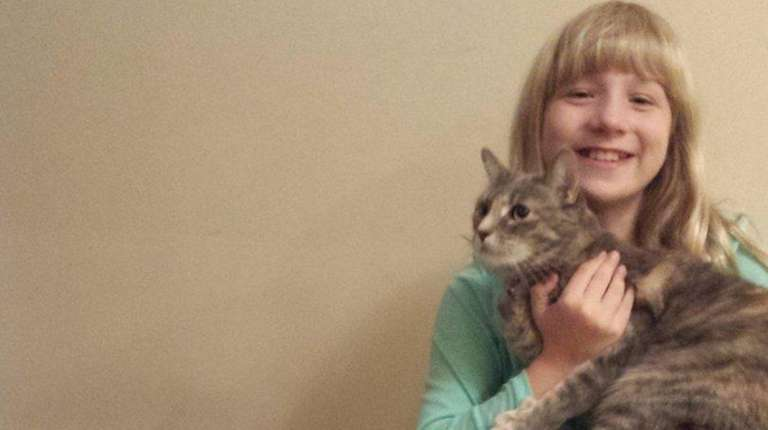 Emily Hamm with Nermal, left, and Sophie at