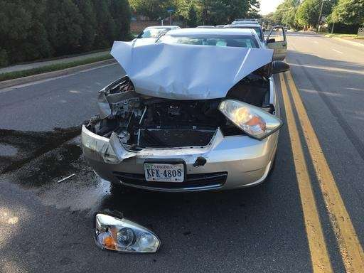 A car involved in an accident sits in