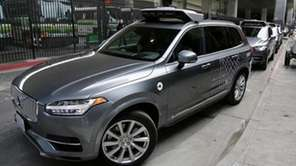 An Uber driverless car heads out for a