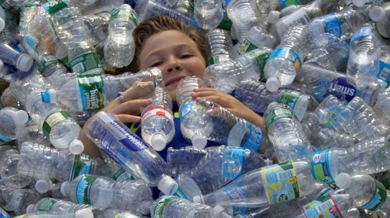 Kidsday reporter Joseph Pace swims among bottles collected