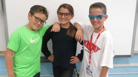Kidsday reporters, from left, Joseph Pace, Isabella Basini