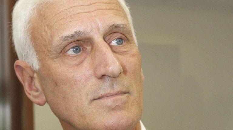 Attorney William Ferris of Islandia, speaks to the