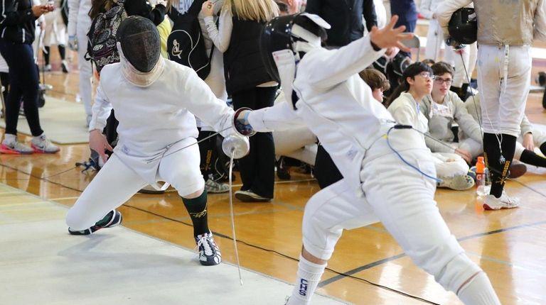 Ward Melville's Ben Rogak (left) defeated James Moore
