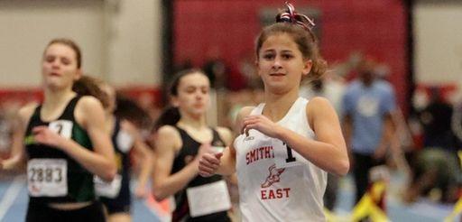 Smithtown East's Gabrielle Schneider, right, wins the girls