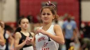 Smithtown East's Gabrielle Schneider, right, wins the girls