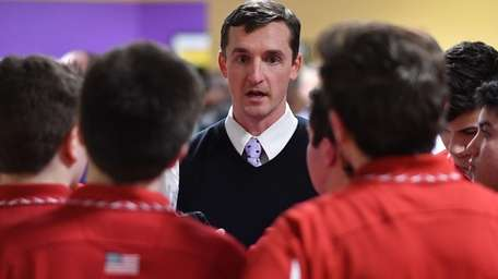 Chaminade boys bowling coach Terence Fitzgibbon, center, talks