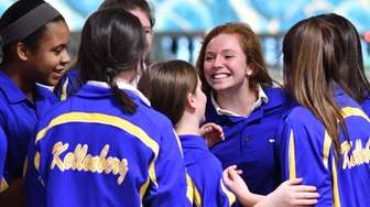 Kellenberg girls bowling teammates celebrate after winning over