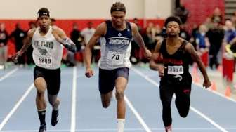 Huntington's Kyree Johnson, center, wins the 55-meter dash,