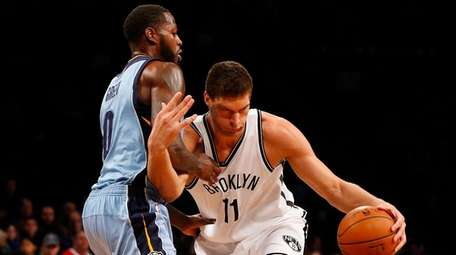 Brook Lopez #11 of the Brooklyn Nets attempts