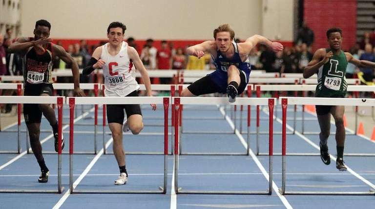 West islip's Andrew Lauriget crosses the final hurdle