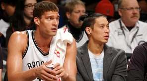Brook Lopez, #11, and Jeremy Lin, #7, of