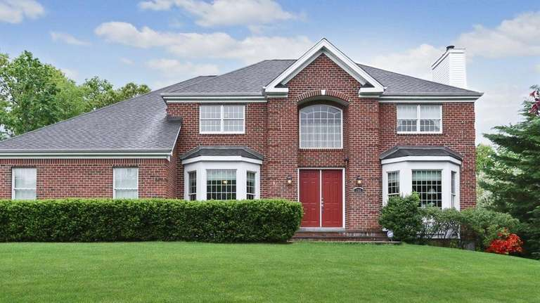 This five-bedroom, brick-faced Smithtown house is listed for