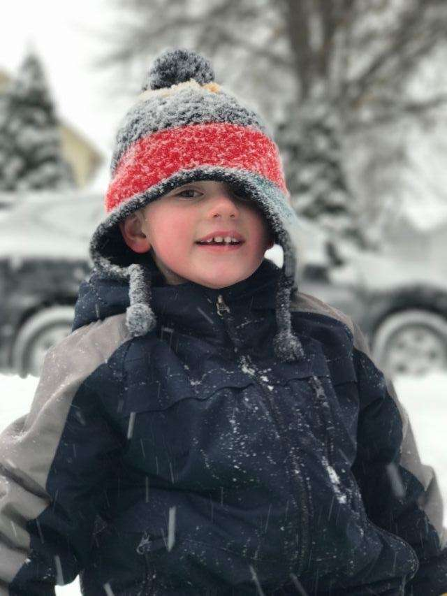 Colton playing in the snow in New Hyde