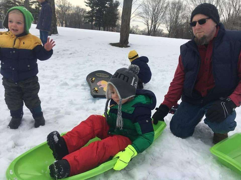 Sledding in Sea Cliff with Mom and Dad.