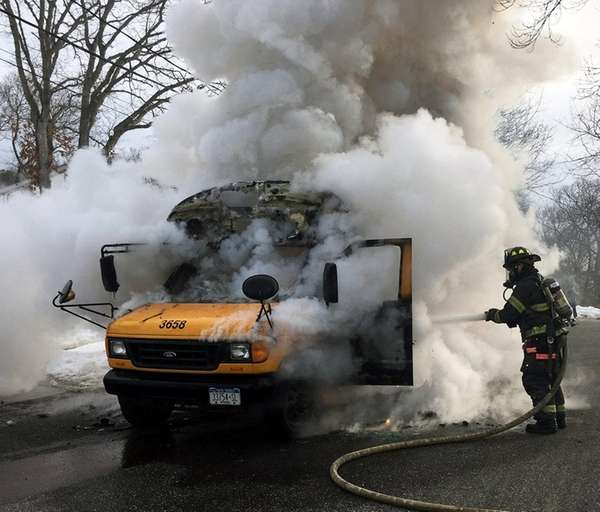 Firefighters respond to a mini school bus fire