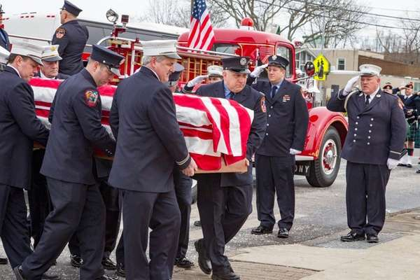 The coffin of FDNY Robert Newman arrives at