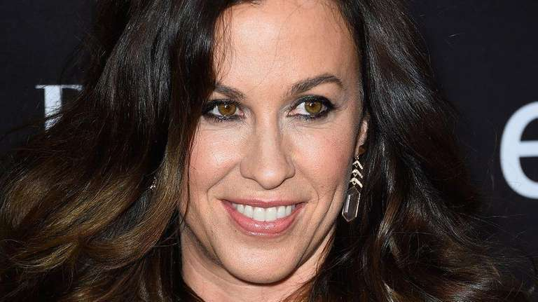Alanis Morissette arrives at an event on May