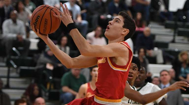 Chaminade's Michael O'Connell sinks a layup against Holy