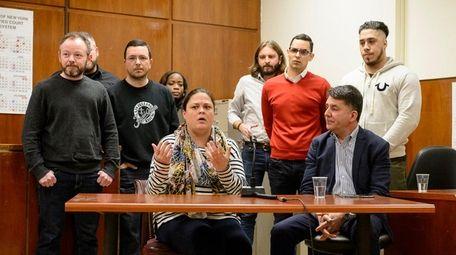 Juror Cateryn Kiernan (C) speaks during a press