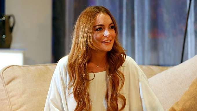 Lindsay Lohan says Americans need to join President