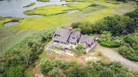 This waterfront Brookhaven home, with five bedrooms and