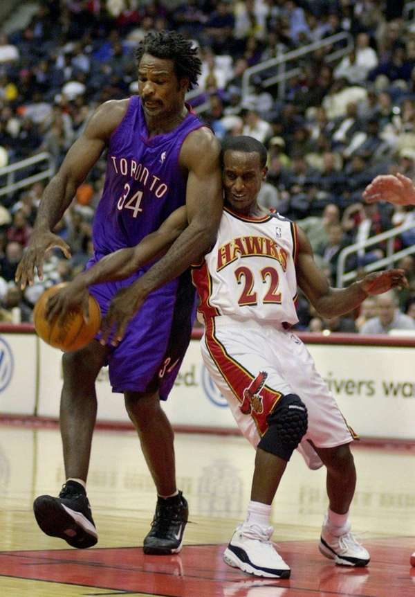 Atlanta Hawks' guard Brevin Knight knocks the ball