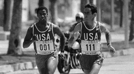 Denzel Washington left, keeps an eye on Olympian