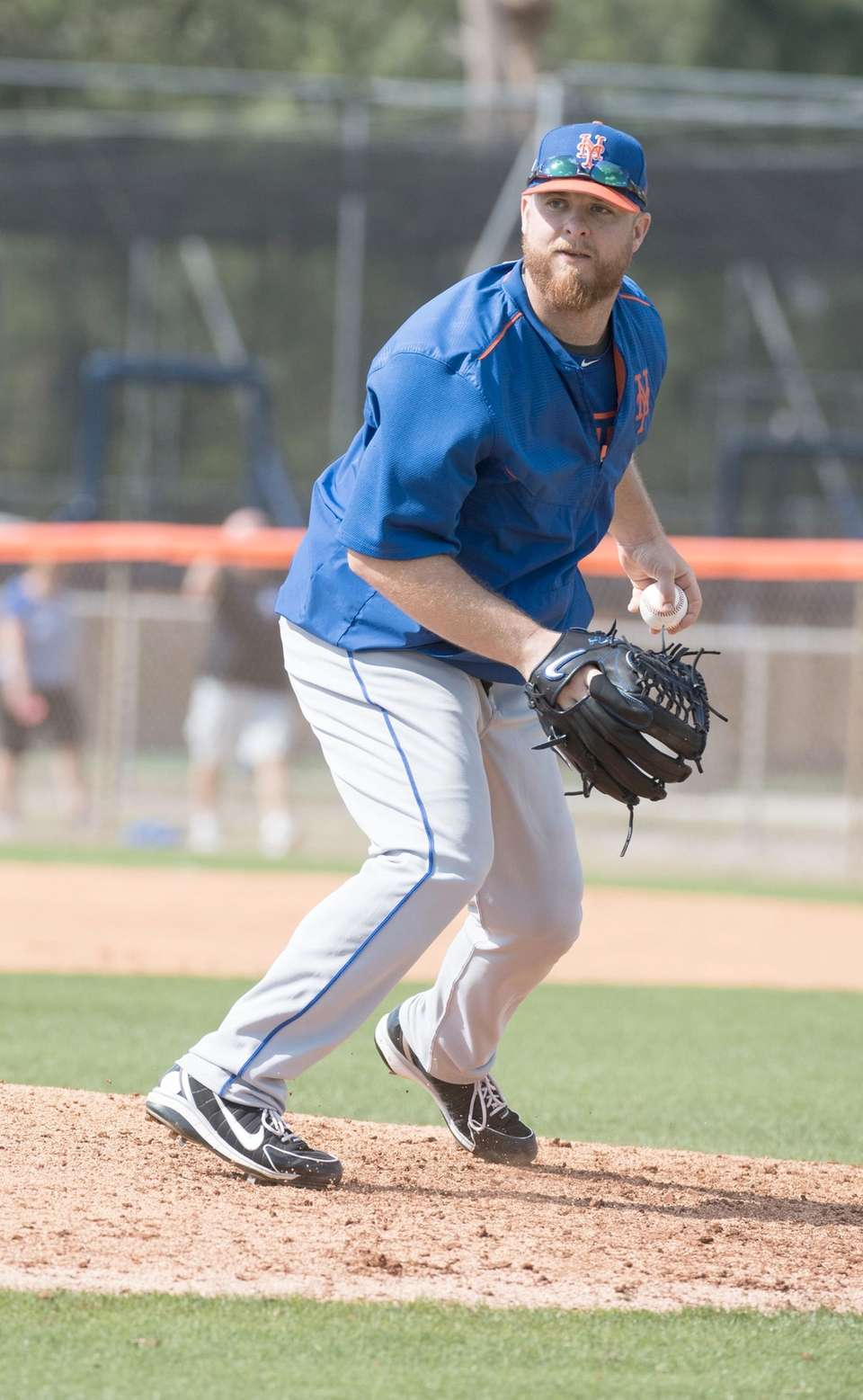 Mets pitcher Josh Edgin fields the ball during