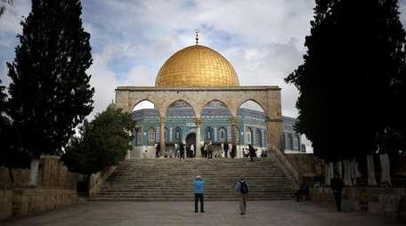 Tourists visit the Dome of the Rock shrine