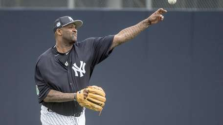 New York Yankees pitcher CC Sabathia warms up