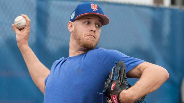 Mets pitcher Zack  Wheeler throws during spring training