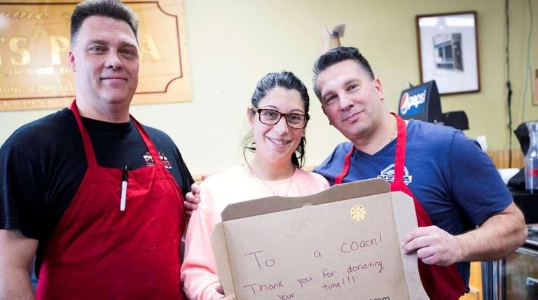 Co-owners of Albert's Pizza in Ronkonkoma stand on