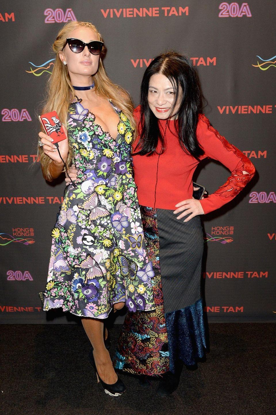 Paris Hilton poses with Vivienne Tam at the