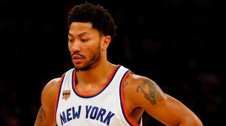 Derrick Rose of the Knicks looks on during