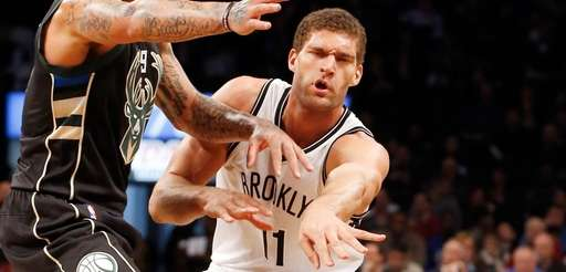 Brook Lopez #11 of the Brooklyn Nets passes